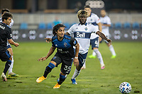 SAN JOSE, CA - OCTOBER 07: Gilbert Fuentes  #35 of the San Jose Earthquakes and Leonard Owusu #17 of the Vancouver Whitecaps battle for the ball during a game between Vancouver Whitecaps and San Jose Earthquakes at Eathquakes Stadium on October 07, 2020 in San Jose, California.