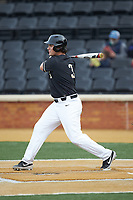 Bobby Seymour (3) of the Wake Forest Demon Deacons follows through on his swing against the Notre Dame Fighting Irish at David F. Couch Ballpark on March 10, 2019 in  Winston-Salem, North Carolina. The Fighting Irish defeated the Demon Deacons 8-7 in 10 innings in game two of a double-header. (Brian Westerholt/Four Seam Images)