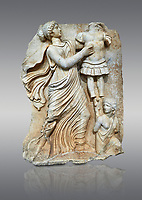 Roman Sebasteion relief  sculpture of a Goddess inscribing a trophy, Aphrodisias Museum, Aphrodisias, Turkey. <br /> <br /> A draped goddess strides forward to inscribe a military trophy to which is bound a kneeling female captive. The goddess is probably a personification such as Honour, Virtue or Courage.