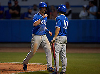 Jesuit Tigers Tyler Corish (14) fist bumps Jack Martinez (10) after scoring a run during a game against the IMG Academy Ascenders on April 21, 2021 at IMG Academy in Bradenton, Florida.  (Mike Janes/Four Seam Images)