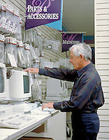 Senior male shopping for a computer in a computer store. trade, shop, computers, accessories, shopping, man. D. Borie, M.R. # D-15.