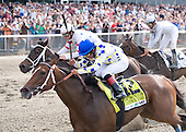 Southern Equine Stables' Champagne d'Oro, a daughter of Medaglia d'Oro, wins the Grade 1, $300,000 Acorn Stakes at Belmont Park for trainer EJ Guillot and rider Martin Garcia. Amen Hallelujah was second.