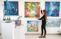 BNPS.co.uk (01202) 558833. <br /> Pic: CorinMesser/BNPS<br /> <br /> Pictured: Ally hangs 'Sweet Dreams' by Julie Ann Scott. <br /> <br /> Ally Webb puts the finishing touches to displays as she prepares to reopen the Westover Gallery in Bournemouth, Dorset on Monday.