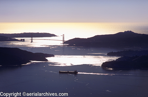 aerial photograph of a silhouette Golden Gate bridge, Marin Headlands, Angel Island, and an oil tanker in San Francisco Bay, California
