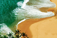 Praya do Vidigal aerial view, with palm trees and ocean wave shapes on the sandy beach, near Ipanema beach in Rio de Janeiro, Brazil