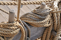 Ropes on wooden sailboat upper deck (Licence this image exclusively with Getty: http://www.gettyimages.com/detail/101682977 )