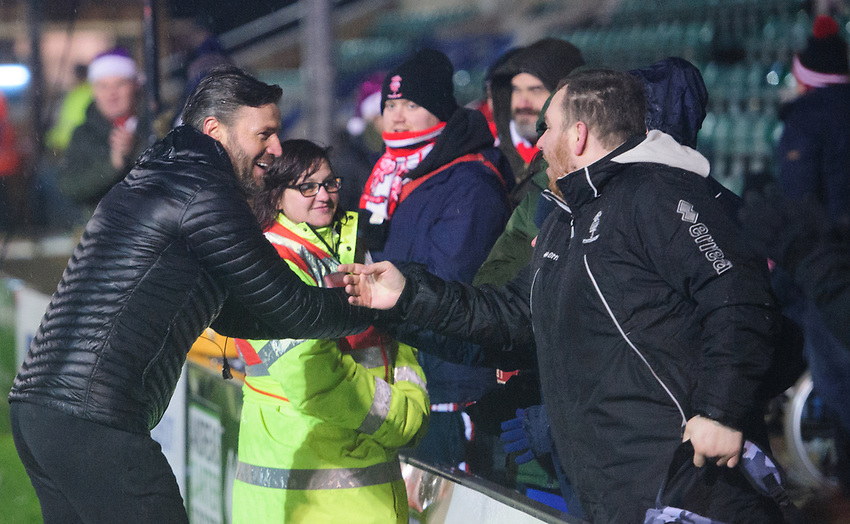 Lincoln City's assistant manager Nicky Cowley with a group of fans at the end of the game<br /> <br /> Photographer Chris Vaughan/CameraSport<br /> <br /> The EFL Sky Bet League Two - Saturday 15th December 2018 - Lincoln City v Morecambe - Sincil Bank - Lincoln<br /> <br /> World Copyright © 2018 CameraSport. All rights reserved. 43 Linden Ave. Countesthorpe. Leicester. England. LE8 5PG - Tel: +44 (0) 116 277 4147 - admin@camerasport.com - www.camerasport.com