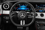 Car pictures of steering wheel view of a 2021 Mercedes Benz E-Class AMG-Line 5 Door Wagon Steering Wheel
