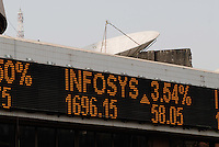 INDIA, Mumbai, stock exchange in Dalal Street, news ticker BSE Bombay Stock Exchange index, notation of Infosys company / INDIEN, Mumbai, indische Boerse