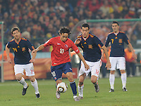 Chile's Jorge Valdivia looks to drbible past Spanish pursuit. Spain won Group H following a 2-1 defeat of Chile in Pretoria's Loftus Versfeld Stadium, Friday, June 25th, at the 2010 FIFA World Cup in South Africa..