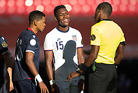 ZAPOPAN, MEXICO - MARCH 21: Andres Perea #15 of the United States has a laugh with referee Daneon Parchment during a game between Dominican Republic and USMNT U-23 at Estadio Akron on March 21, 2021 in Zapopan, Mexico.