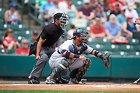 Home plate umpire Roberto Ortiz and Columbus Clippers catcher Guillermo Quiroz (29) await the pitch during a game against the Rochester Red Wings on June 16, 2016 at Frontier Field in Rochester, New York.  Rochester defeated Columbus 6-2.  (Mike Janes/Four Seam Images)