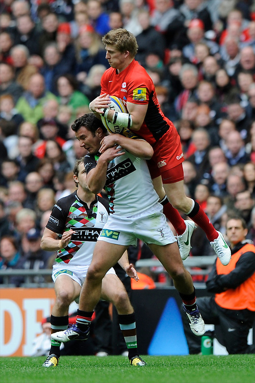 David Strettle of Saracens outjumps George Lowe of Harlequins during the Aviva Premiership match between Saracens and Harlequins at Wembley Stadium on Saturday 31st March 2012 (Photo by Rob Munro)