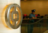 A security guard stands near a Bank of China logo at the bank's regional headquarter in Shanghai, China..