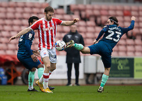 20th March 2021; Bet365 Stadium, Stoke, Staffordshire, England; English Football League Championship Football, Stoke City versus Derby County; Patrick Roberts of Derby County takes a back kick on the ball in front of Rhys Norringrton-Davies of Stoke City