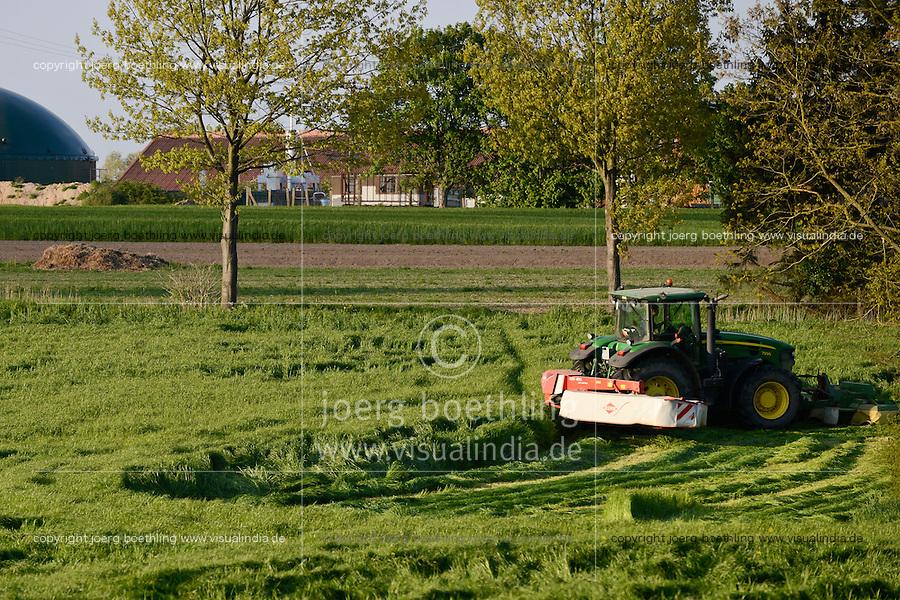 GERMANY, Plauderhagen, grass cutting for silage or hay / Deutschland, Plauerhagen, Grasschnitt mit John Deere Traktor und Mähwerk fuer Heu Herstellung