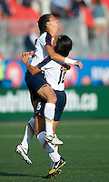Shannon Boxx celebrates her goal in the 2nd minute with Angela Hucles. The US Women's National Team defeated the Canadian Women's National Team, 4-0, at BMO Field in Toronto during an international friendly soccer match on May 25, 2009.