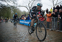 Niki Terpstra (NLD/Etixx-QuickStep) over the slippery Kemmelberg cobbles<br /> <br /> 77th Gent-Wevelgem 2015