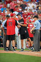 Cincinnati Reds great Sean Casey and New York Yankees great Paul O'Neill shake hands during the lineup exchange with umpires JJ January (left) and Junior Valentine (right) during the All-Star Legends and Celebrity Softball Game on July 12, 2015 at Great American Ball Park in Cincinnati, Ohio.  (Mike Janes/Four Seam Images)