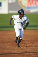Seuly Matias (25) of the Wilmington Blue Rocks takes off for third base against the Fayetteville Woodpeckers at Frawley Stadium on June 6, 2019 in Wilmington, Delaware. The Woodpeckers defeated the Blue Rocks 8-1. (Brian Westerholt/Four Seam Images)