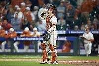 Texas Longhorns catcher Silas Ardoin (4) on defense against the Arkansas Razorbacks in game six of the 2020 Shriners Hospitals for Children College Classic at Minute Maid Park on February 28, 2020 in Houston, Texas. The Longhorns defeated the Razorbacks 8-7. (Brian Westerholt/Four Seam Images)