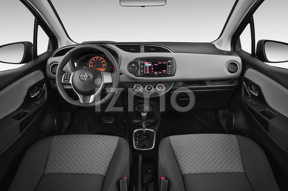 Stock photo of straight dashboard view of a 2015 Toyota Yaris LE 3-Door Liftback AT 3 Door Hatchback Dashboard
