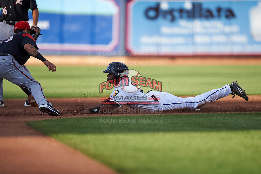 Akron RubberDucks center fielder Greg Allen (4) slides into second base as shortstop C.J Hinojosa (25) covers the bag during a game against the Richmond Flying Squirrels on July 26, 2016 at Canal Park in Akron, Ohio .  Richmond defeated Akron 10-4.  (Mike Janes/Four Seam Images)
