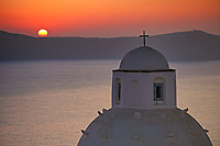 The sunset from Agios Minas in Fira which is the capital of Santorini island, Greece