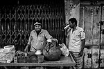 A man drinks sattu (A drink made up of different pulses flour) in a market in Kolkata, India.