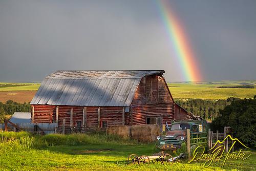 Log red barn, rainbow, Idaho