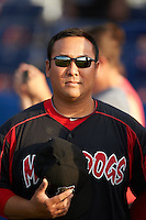 Batavia Muckdogs pitching coach Brendan Sagara (28) during the national anthem before a game against the Auburn Doubledays July 10, 2015 at Dwyer Stadium in Batavia, New York.  Auburn defeated Batavia 13-1.  (Mike Janes/Four Seam Images)