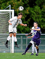 11 September 2009: University of Vermont Catamount midfielder/backfielder Sean Sweeney, a Freshman from Cromwell, CT, jumps high to get a header against the University of Portland Pilots, in the first round of the 2009 Morgan Stanley Smith Barney Soccer Classic held at Centennial Field in Burlington, Vermont. The Catamounts and Pilots battled to a 1-1 double-overtime tie. Mandatory Photo Credit: Ed Wolfstein Photo