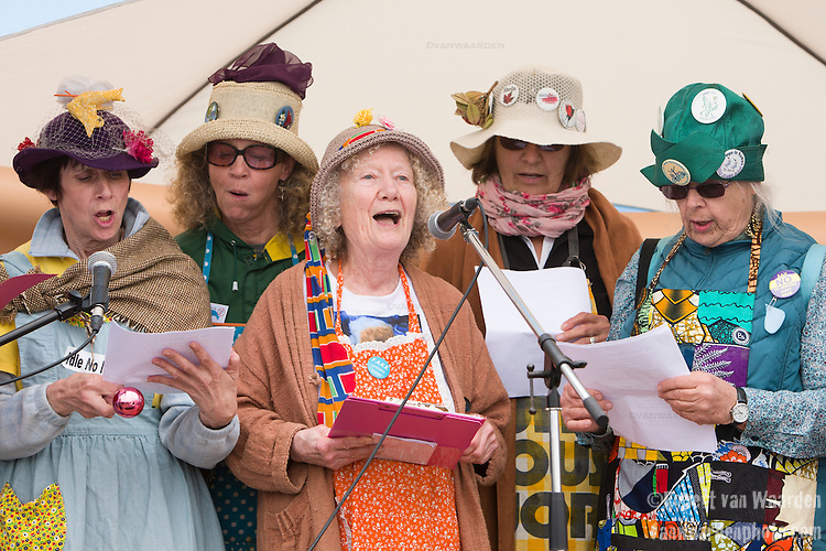 The Raging Grannies preform at the march at the End of the Line. On May 30, 2015, over 500 Canadian citizens and First Nations marched in Red Head, Saint John, at the End of the Line for the proposed Energy East pipeline. The people were protesting the proposed mega pipeline and the tank terminal that would destroy and the Red Head community and endanger the Bay of Fundy. If approved, TransCanada's Energy East pipeline would travel 4600km from Alberta to Saint John, New Brunswick, shipping 1.1 million barrels of crude oil and bitumen for export through the Bay of Fundy, a critical habit for Right whales and home to thousands of jobs in Tourism and Fishing.
