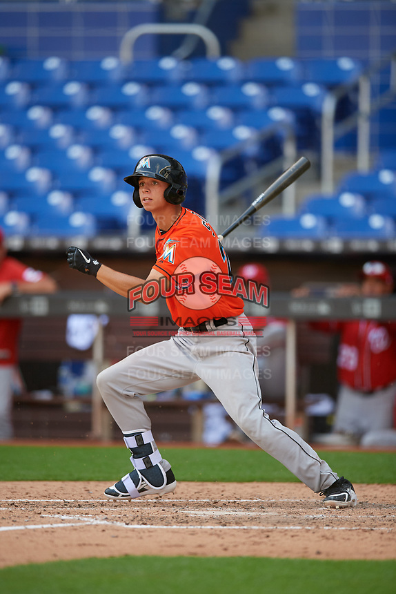 Miami Marlins Connor Scott (24) follows through on a swing during a Florida Instructional League game against the Washington Nationals on September 26, 2018 at the Marlins Park in Miami, Florida.  (Mike Janes/Four Seam Images)