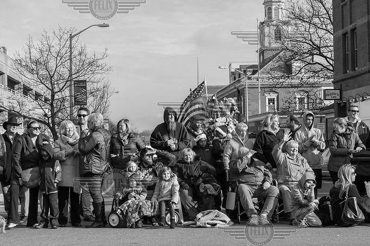 Spectators line the street at Brockton Holiday parade.