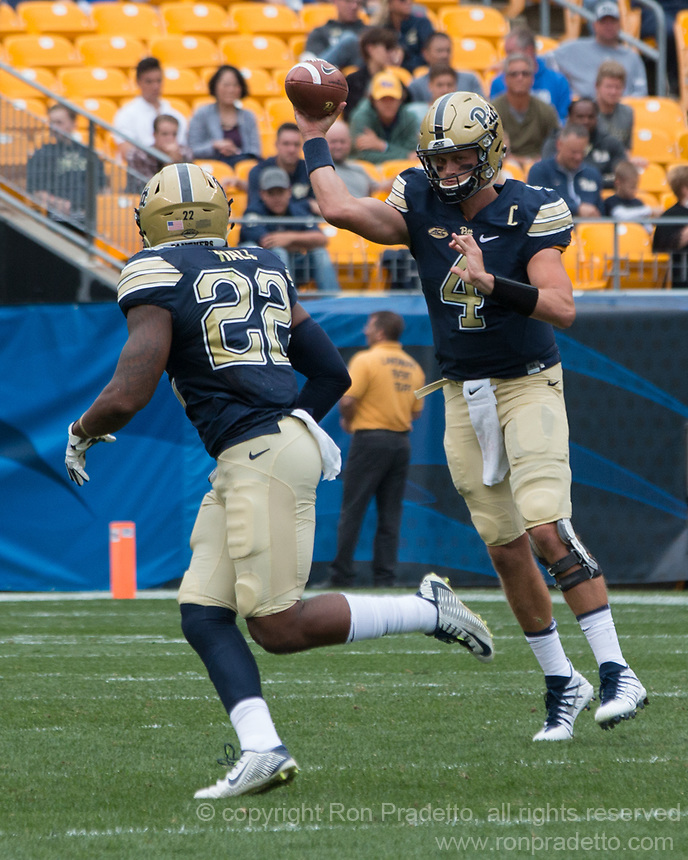 Pitt quarterback Max Browne passes the ball to running back Darrin Hall. The Pitt Panthers defeated the Youngstown State Penguins 28-21 in overtime at Heinz Field, Pittsburgh, Pennsylvania on September 02, 2017.