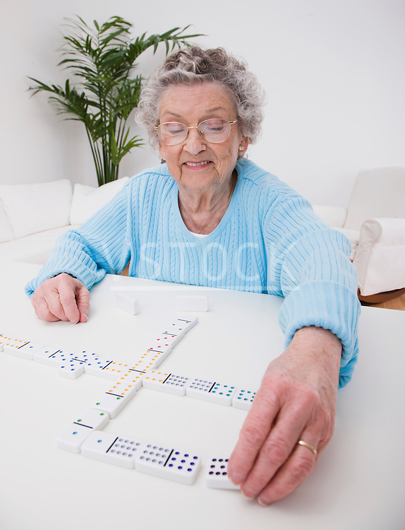 Senior woman playing dominoes