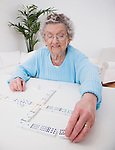 Senior woman playing dominoes