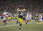 Green Bay Packers running back John Kuhn rushes into the end zone for a score against the New York Giants during the fourth quarter of the game at Lambeau Field in Green Bay, Wis., on Dec. 26, 2010.