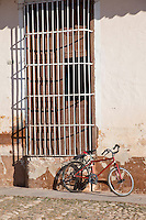 Cuba, Trinidad.  Bicycle and Window Grille.