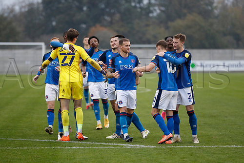 8th November 2020; SkyEx Community Stadium, London, England; Football Association Cup, Hayes and Yeading United versus Carlisle United; Carlisle United players celebrate after Gavin Reilly of Carlisle United winning penalty goal puts Carlisle United through to the 2nd round
