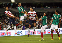 MEXICO CITY, MEXICO - AUGUST 15, 2012:  Terrence Boyd (18) and Jermaine Jones (13) of the USA MNT go up for a header against Jorge Torres Nilo (20) of  Mexico during an international friendly match at Azteca Stadium, in Mexico City, Mexico on August 15. USA won 1-0.