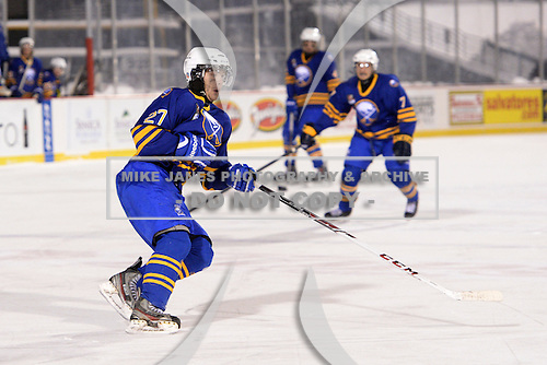 Buffalo Junior Sabres forward Nick Smith (27) during a game against the St. Michaels Buzzers at the Frozen Frontier outdoor game at Frontier Field on December 15, 2013 in Rochester, New York.  St. Michael's defeated Buffalo 5-4.  (Copyright Mike Janes Photography)