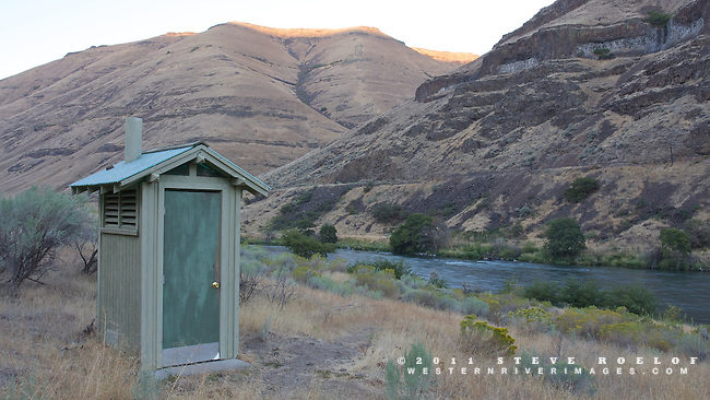 An outhouse and campsite on the Deschutes River.
