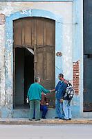 Cuba, Havana.  Men Greeting One Another.