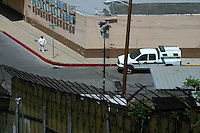 An US Broder Patroll unit checks the  wall or fence separating the city of  Nogales, Sonora, in North Mexico, with the USA.