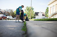 """Molly Baumann, left, and Sally Finkel pick up trash near the Hawthorne Community Center during """"Circle the City with Service,"""" the Kiwanis Circle K International's 2015 Large Scale Service Project, on Wednesday, June 24, 2015, in Indianapolis. (Photo by James Brosher)"""