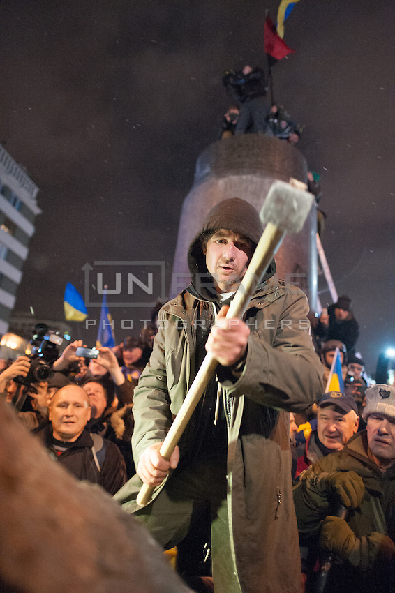 The statue of Lenin on Boulevard of Shevchenko in Kiev has been torn down by group of nationalists, as protests against current government and president Yanukovich spread around the country. Many Ukrainians believe that this action was carefully planned by Ukrainian and Russian government to provoke the opposition party and to raise the conflict between East and West of Ukraine.