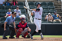 Gavin Sheets (23) of the Kannapolis Intimidators follows through on his swing against the Hagerstown Suns at Kannapolis Intimidators Stadium on July 9, 2017 in Kannapolis, North Carolina.  The Intimidators defeated the Suns 3-2 in game one of a double-header.  (Brian Westerholt/Four Seam Images)
