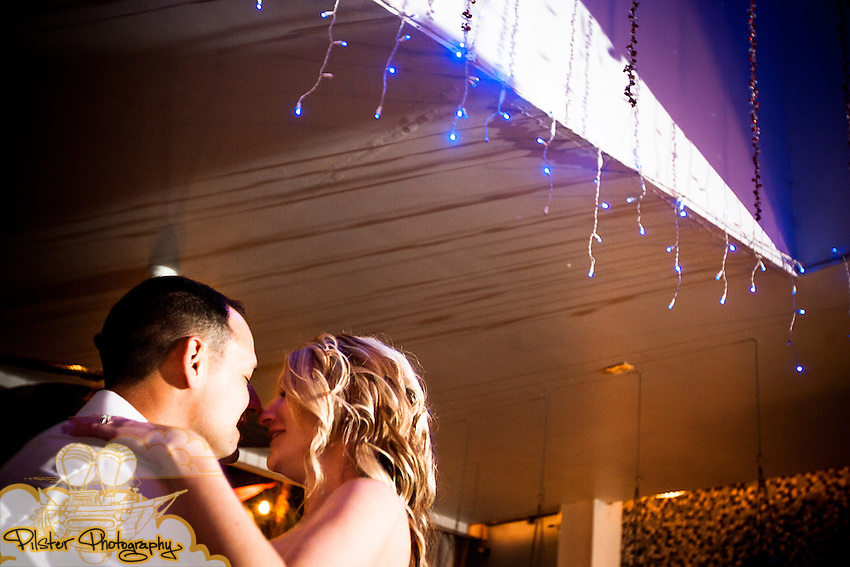 Terry Wooldrige and Rachael Underwood at their wedding reception on Monday, December, 31, 2012 at the City Tropics Bistro in Indialantic, Florida. Their ceremony took place at the Melbourne Beach Hilton. (Chad Pilster of PilsterPhotography.net)